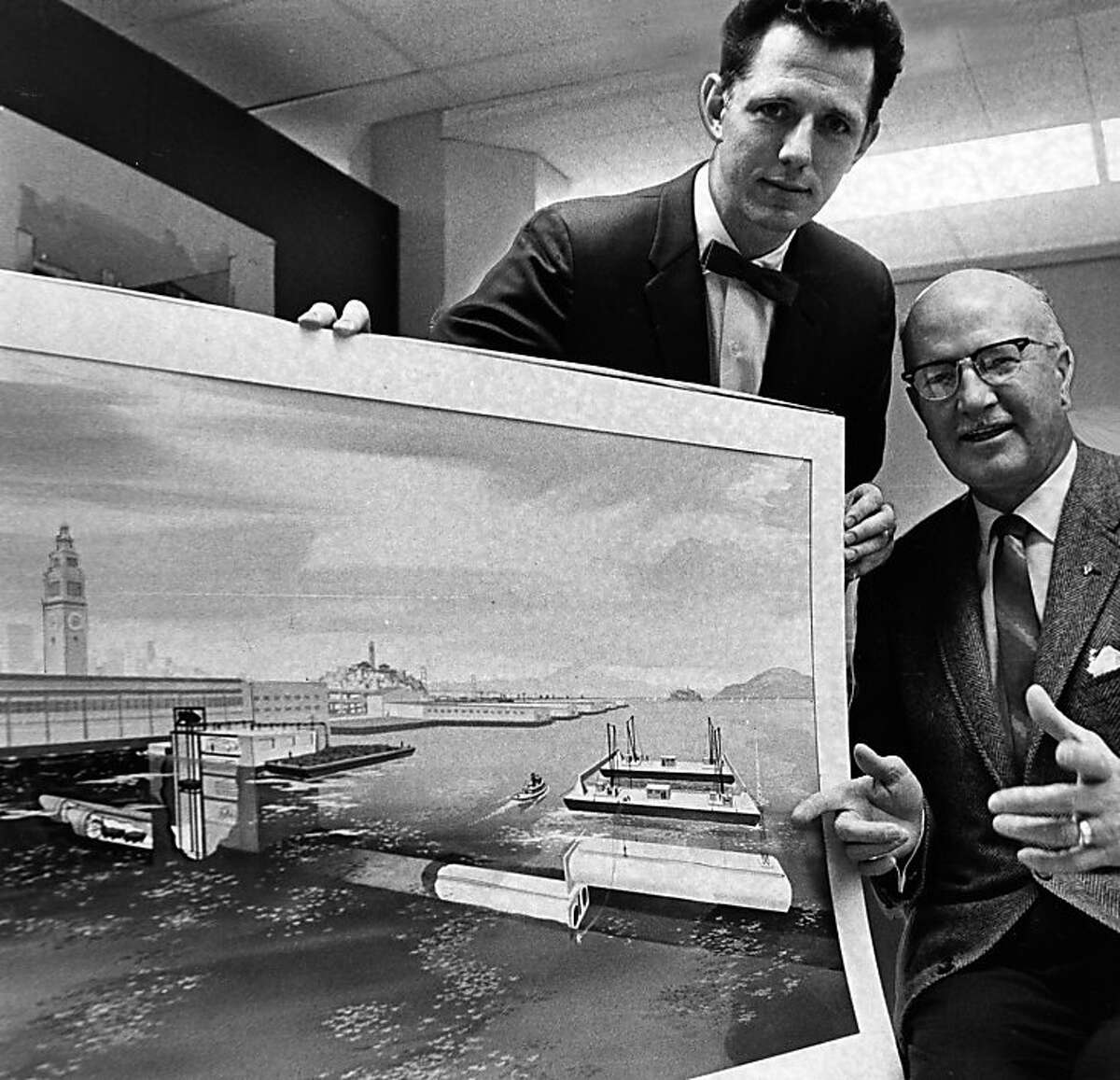 Project engineer Martin Kelley (left) and Peter Kiewit Co. chief engineer C.L. Gallimore smile over plans for the BART bay tube on March 11, 1966.Project engineer Martin Kelley (left) and Peter Kiewit Co. chief engineer C.L. Gallimore smile over plans for the BART bay tube on March 11, 1966.