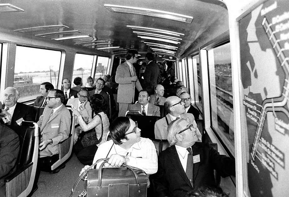 FILE - Passengers on the relatively new train system peer out the windows, in this photo taken Sept. 12, 1972. The interior photo shows the look of the earlier BART trains, including a view of the seats that were later part of a criminal conspiracy in 1981. Photo: Barney Peterson, The Chronicle