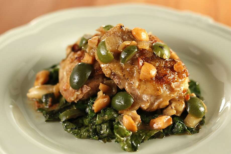 Braised Chicken Thighs with Castelvetrano Olives & Toasted Almonds in San Francisco, Calif., on August 4, 2010. Food styled by Britt Billmaier. Photo: Craig Lee, Special To The Chronicle