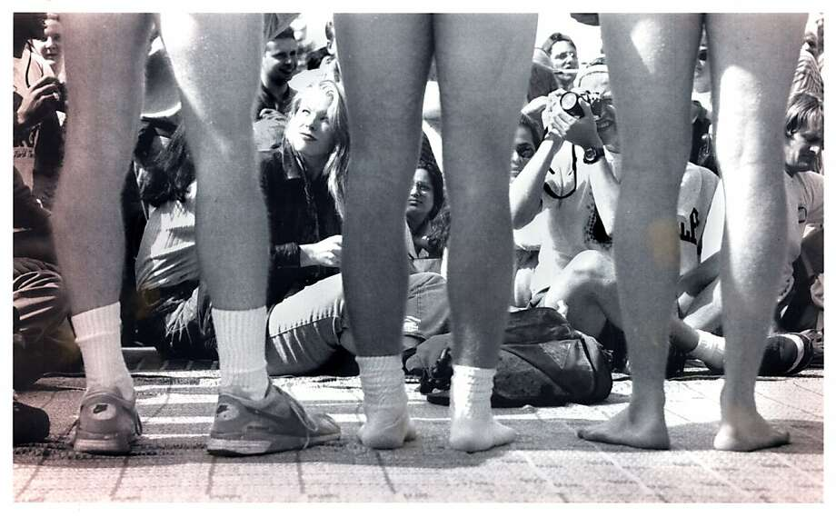 three students stand nude in UC Berkeley's Sproul Plaza to protest public nudity laws. Photo taken in 1992. Photo: Michael Maloney, The Chronicle