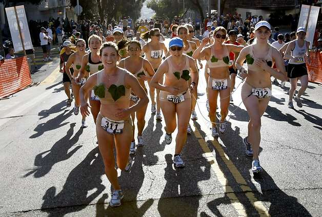 A group of women wearing skin colored outfits with fig leaves on their chest ran up Hayes Street sunday. The 98th running of the Bay to Breakers in San Francisco, CA featured a police crackdown on public drinking. Photo: Brant Ward, The Chronicle