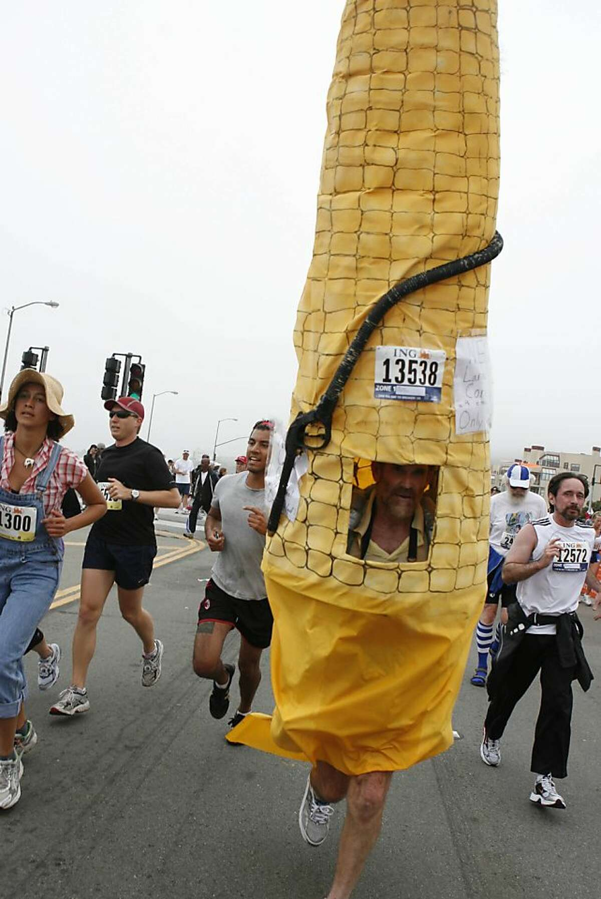John Hearney of Oakland runs as a giant corn cob during the 97th annual ING Bay to Breakers 12k on Sunday, May 18 2008.