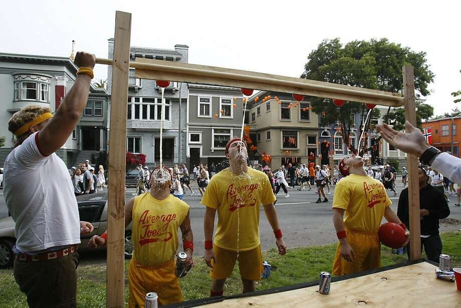 Ryan Eklund, left, pours beer for thirsty runners Byron Tuyay, Mark Shirian and Naum Shuminov along the race route on Fell Street near Golden Gate Park during the 97th annual ING Bay to Breakers 12k foot race in San Francisco, Calif., on May 18, 2008. Photo by Michael Maloney / San Francisco Chronicle Photo: Michael Maloney, The Chronicle