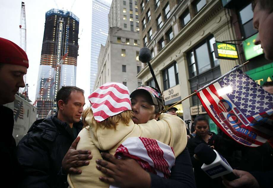 Dionne Layne, facing camera, hugs Mary Power as they react to the news of the death of Osama bin Laden, Monday, May 2, 2011 in New York. At left is the rising tower, 1 World Trade Center, also known as the Freedom Tower. Photo: Mark Lennihan, AP