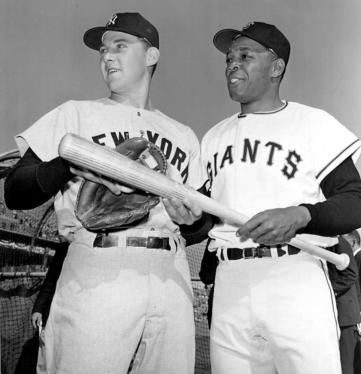 In this Oct. 4, 1962, file photo, Tom Tresh, left, of the New York Yankees, and Willie Mays, of the San Francisco Giants, talk before the first game of the World Series in San Francisco. Two ballparks and a half century after the Giants relocated from New York, San Francisco Giants fans still are waiting for a World Series championship that eluded them on three occasions.