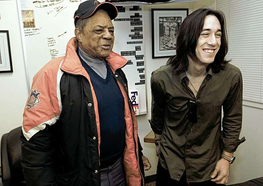 Tim Lincecum of the San Francisco Giants stops to meet with Giants legend Willie Mays after he was named the National League Cy young Award winner today for the second straight year. Lincecum and Mays at the Giants clubhouse at AT&T Ballpark  in  San Francisco, Calif. on Thursday November 19, 2009. Photo: Michael Macor, The Chronicle