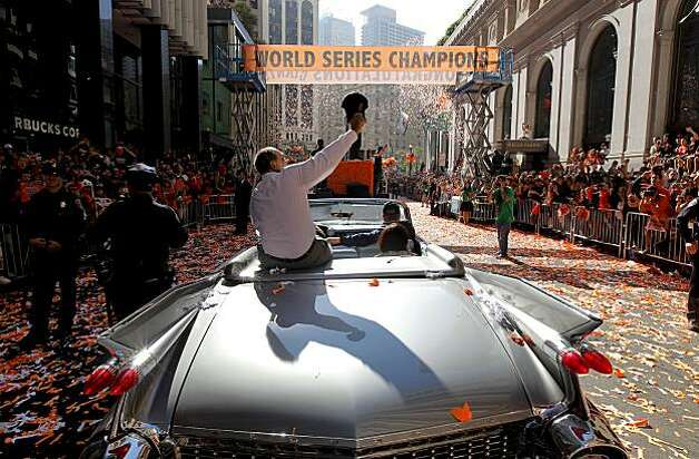 Famed Giants' player Willie Mays waves to fans, as the City of San Francisco celebrates the World Series Champion Giants with a parade down Market Street, on Wednesday Nov. 3, 2010 in San Francisco, Calif. Photo: Michael Macor, San Francisco Chronicle