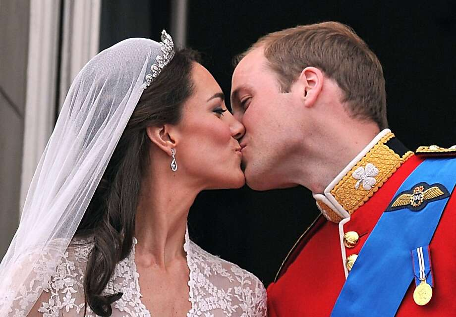 Prince William and his wife Kate Middleton, Duchess of Cambridge, kiss on the balcony of Buckingham Palace in London, following their wedding on April 29, 2011. Photo: John Stillwell, AFP/Getty Images