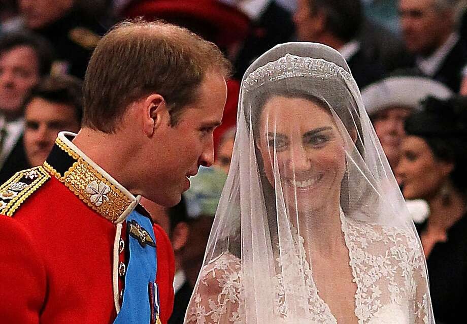 Britain's Prince William (left) looks at his bride Kate Middleton during the Royal wedding ceremony at Westminster Abbey in London on April 29, 2011. Photo: Dominic Lipinski, AFP/Getty Images