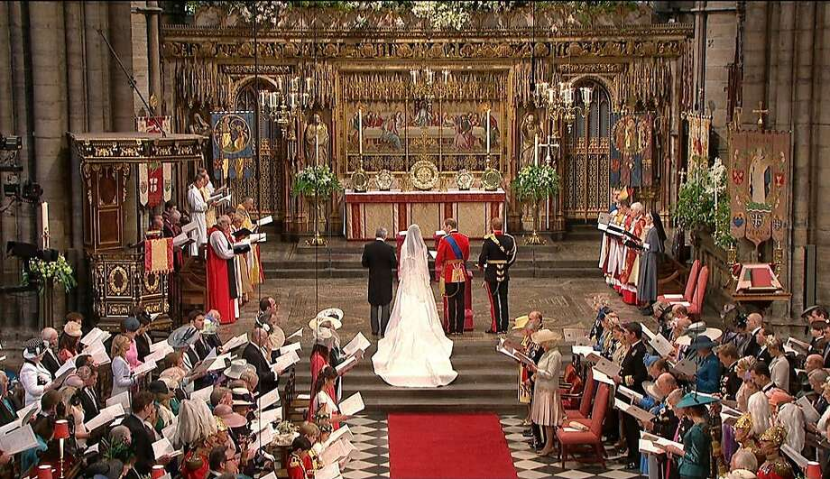 In this image taken from video, Britain's Prince William and Kate Middleton stand at the alter at Westminster Abbey for the Royal Wedding in London on Friday, April, 29, 2011. Photo: AP
