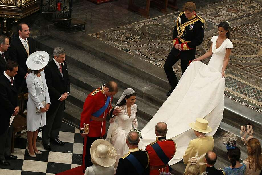 Britain's Prince William bows and his wife Kate, Duchess of Cambridge, curtsies in front of Britain's Queen Elizabeth II  as they leave Westminster Abbey accompanied by his best man Britain's Prince Harry  and her maid of honor Pippa Middleton  after the wedding service at the Royal Wedding in London Friday, April, 29, 2011. Photo: Kirsty Wigglesworth, AP