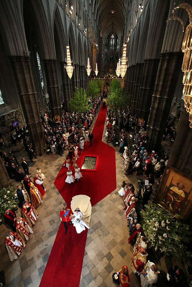 Prince William, Duke of Cambridge and his new bride Catherine, Duchess of Cambridge walk down the aisle at the close of their wedding ceremony at Westminster Abbey on April 29, 2011 in London, England. The marriage of Prince William, the second in line to the British throne, to Catherine Middleton is being held in London today. The Archbishop of Canterbury conducted the service which was attended by 1900 guests, including foreign Royal family members and heads of state. Thousands of well-wishers from around the world have also flocked to London to witness the spectacle and pageantry of the Royal Wedding and street parties are being held throughout the UK. Photo: Richard Pohle, Getty Images
