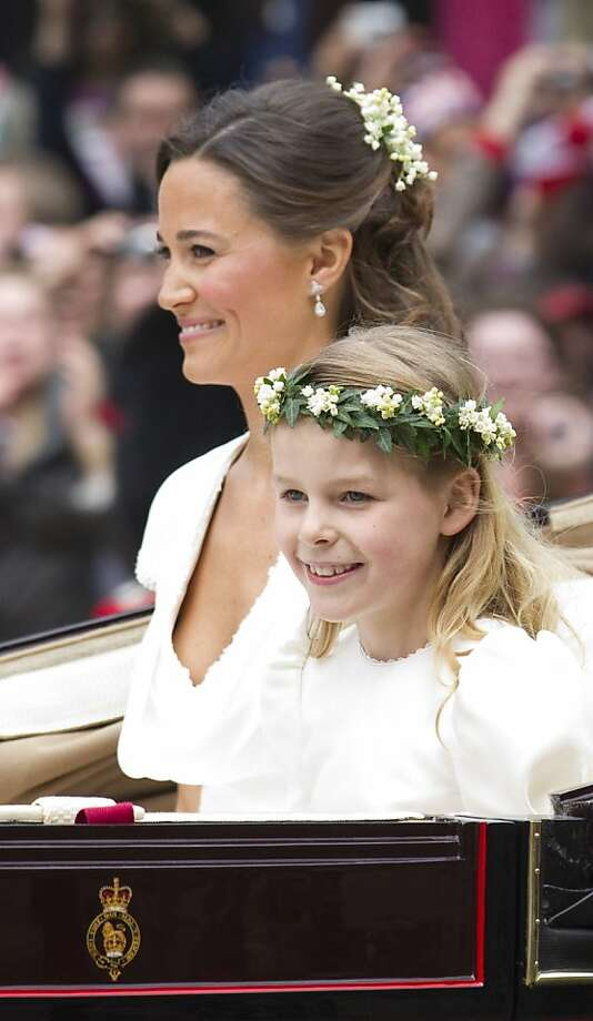 Philippa Middleton, sister of Kate, Duchess of Cambridge, and Maid of Honour travels with a bridesmaid in an Ascot Landau carriage along the Processional Route to Buckingham Palace after the wedding ceremony, in London, on April 29, 2011. Photo: Warren Allott, AFP/Getty Images