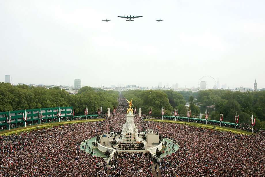 A general view shows the Mall and Victoria Memorial during the fly over by the RAF as well-wishers celebrate the Royal Wedding of Prince William, Duke of Cambridge and Kate, Duchess of Cambridge on April 29, 2011 in London. Photo: Oli Scarff, AFP/Getty Images