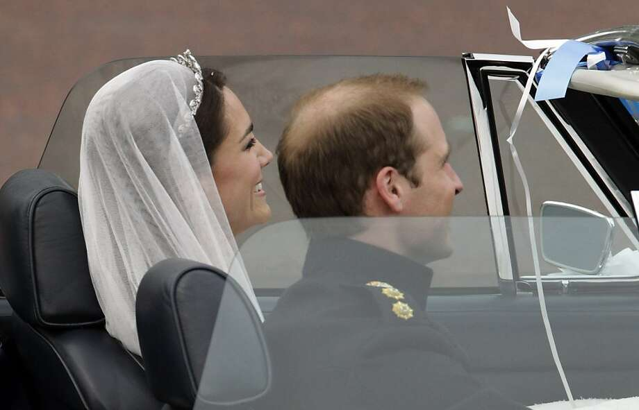 Britain's Prince William and his wife Kate, Duchess of Cambridge drive away from Buckingham Palace in a convertible after the Royal Wedding in London Friday, April, 29, 2011. Photo: Matt Dunham, AP