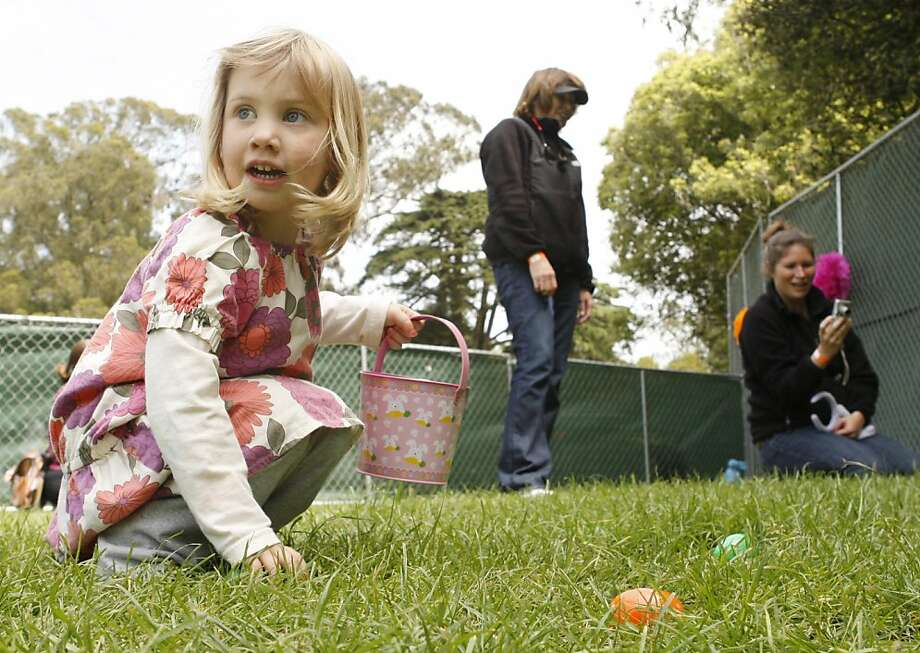 Chase Unger finds an Easter egg at the Spring Eggstravaganza in Golden Gate Park in San Francisco on Saturday. Photo: Alex Washburn, The Chronicle