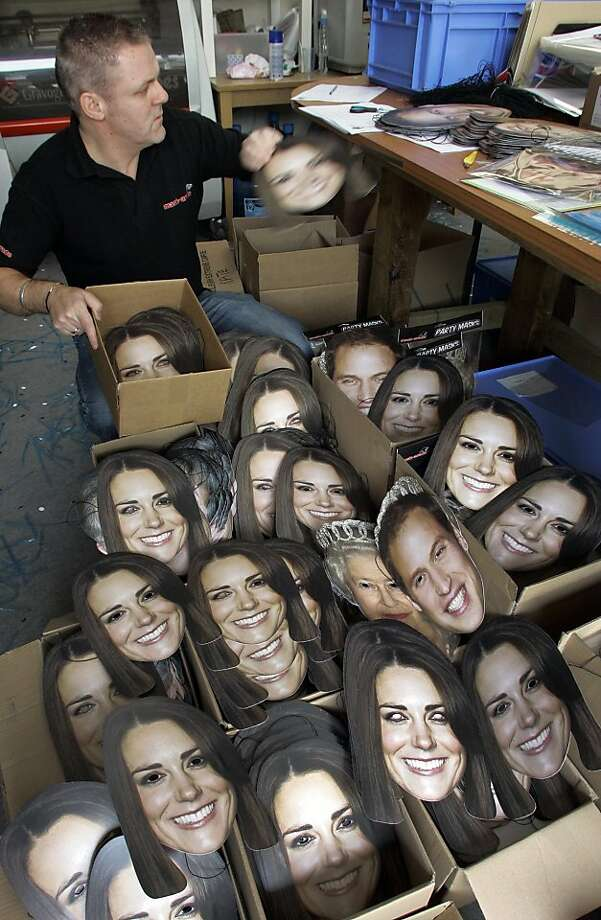 Face masks of Britain's Prince William and his fiancee Kate Middleton are loaded into boxes for shipping at a production plant in Southam, central England Friday April 22, 2011. Over 120,000 of the masks have been sold worldwide with Mask-arade company staff working around the clock to complete orders before the Royal Wedding. Britain's Prince William will marry Kate Middleton in London's Westminster Abbey on Friday April 29. (AP Photo/Martin Cleaver) Photo: Martin Cleaver, AP