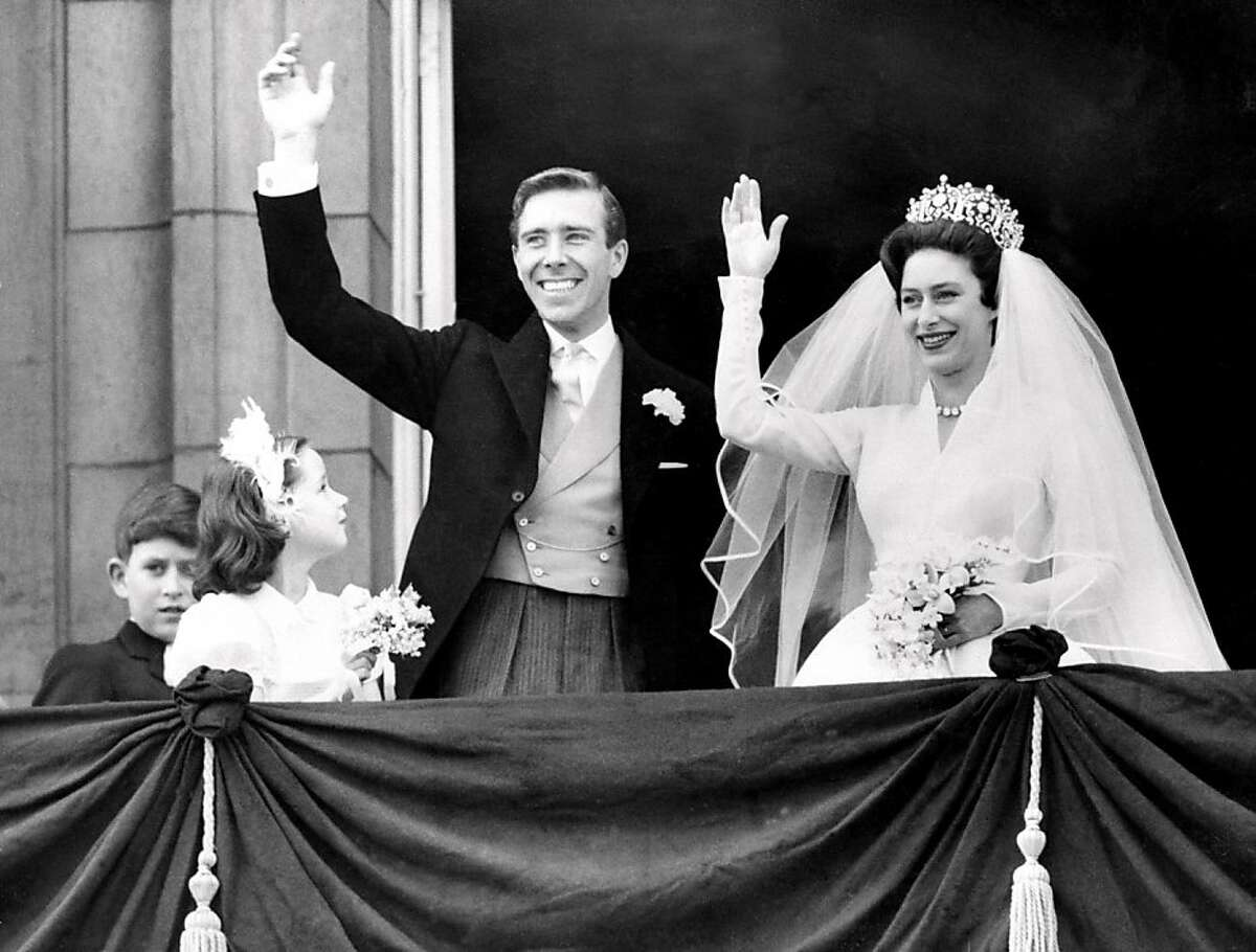 The newly-wed Princess Margaret, the younger sister of Britain's Queen Elizabeth II, and her husband, the photographer Antony Armstrong-Jones wave May 6, 1960 from Buckingham Palace in London on their wedding day.