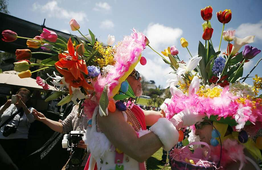 Tom McKinley (left) fixes the hat of John Parr (right) just before the Easter bonnet competition. The Sisters of Perpetual Indulgence put on an Easter celebration in Dolores Park on Sunday. Photo: Anna Vignet, The Chronicle