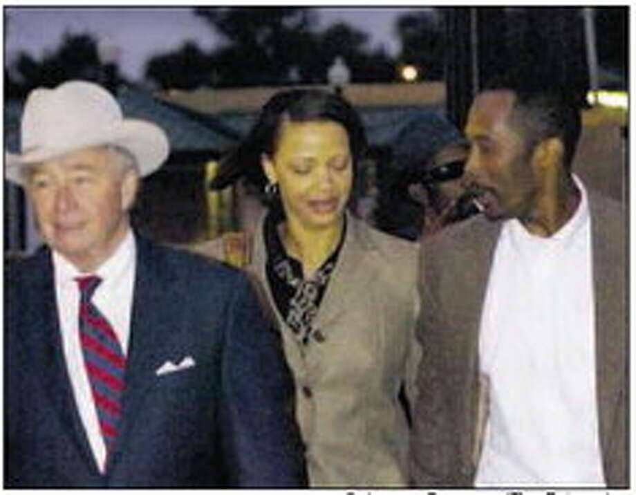 Calvin Walker and his wife Stacey Walker walk behind attorney Dick DeGuerin while exiting the Federal Courthouse on Monday night. Photo: Guiseppe Barranco/The Enterprise