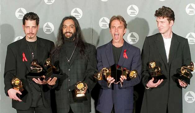 Hard rock band Soundgarden pose with their two Grammy awards for Best Metal Performance and Best Hard Rock Performance at the 37th Annual Grammy Awards in Los Angeles. Photo: DAN GROSHONG/AFP/Getty Images