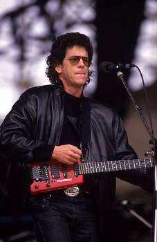 Avant garde musician Lou Reed performs at the John Lennon Memorial Concert in Liverpool, 5th May 1990. Photo: Dave Hogan / Getty Images