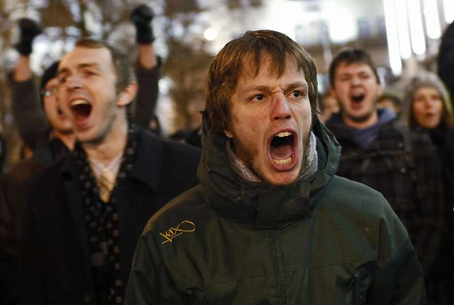 Young protesters shout anti-Putin slogans during protests against alleged vote rigging in Russia's parliamentary elections in Triumphal Square in Moscow, Russia, Tuesday, Dec. 6, 2011. Police clashed Tuesday on a central Moscow square with demonstrators trying to hold a second day of protests against alleged vote fraud in Russia's parliamentary elections. Hundreds of police had blocked off Triumphal Square on Tuesday evening, then began chasing about 100 demonstrators, seizing some and throwing them harshly into police vehicles. (AP Photo/Alexander Zemlianichenko Jr) Photo: Alexander Zemlianichenko Jr, AP