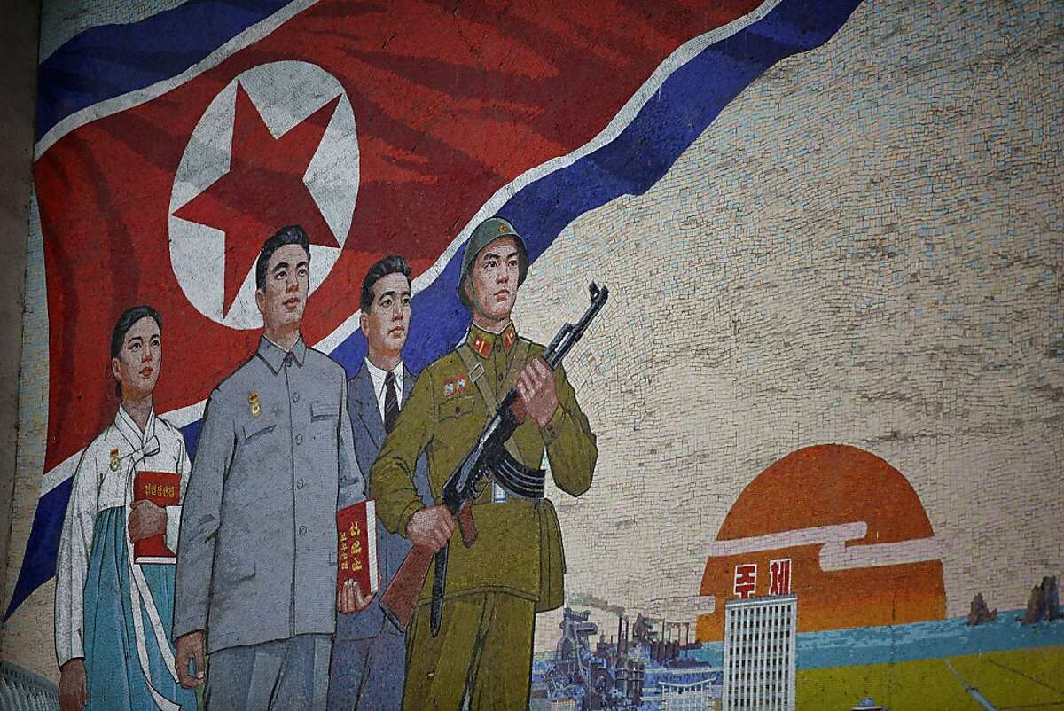 PYONGYANG, NORTH KOREA - APRIL 02: Propaganda mural painting is seen outside People(degrees)¯s Palace of Culture on April 2, 2011 in Pyongyang, North Korea. Pyongyang is the capital city of North Korea and the population is about 2,500,000. (Photo by Feng Li/Getty Images)
