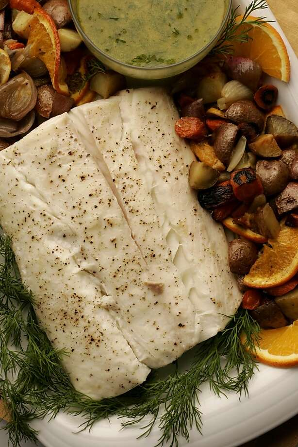 The warm citrus-herb vinaigrette that accompanies the halibut matches the juicy fruit notes in the recommended kosher Rieslings Roasted Halibut with Warm Citrus Herb Vinaigrette & Roasted Mixed Vegetables Photo: Craig Lee, SFC