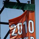One of the decorative championship banners falls victim to the wind early in on the Giants' home opener against the St. Louis Cardinals at AT&T Park in San Francisco on Friday.