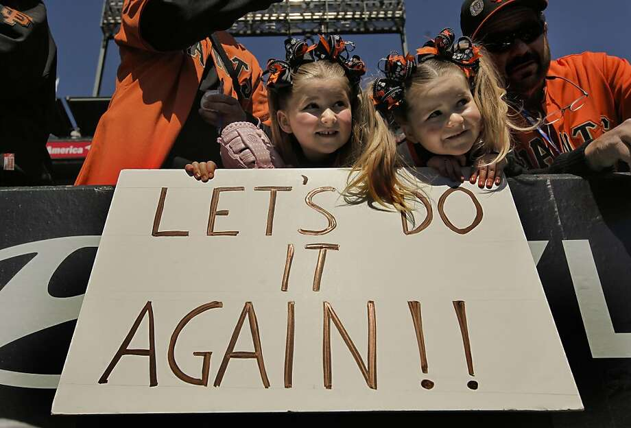 Sisters Julianna Hertzell, 5, and Jenna Hertzell, 3, of San Jose watch batting practice as the San Francisco Giants prepare for their home opener against the St. Louis Cardinals at AT&T Park on Friday. Photo: Michael Macor, The Chronicle