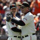 Pitcher Matt Cain threw out the ceremonial first pitch to manager Bruce Bochy before the Giants' home opener against the St. Louis Cardinals at AT&T Park in San Francisco on Friday.