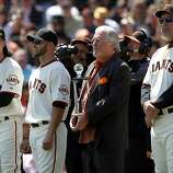 Tim Lincecum and Cody Ross receive trophies for last season's post-season before the Giants' home opener against the St. Louis Cardinals at AT&T Park in San Francisco on Friday. General manager Brian Sabean (center) and manager Bruce Bochy (right) watch.