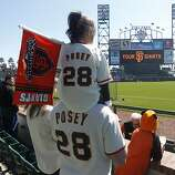 Doug Weller and his daughter Malena, 4, wore matching jerseys and came all the way from Salt Lake City to attend the Giants' home opener against the St. Louis Cardinals at AT&T Park in San Francisco on Friday.