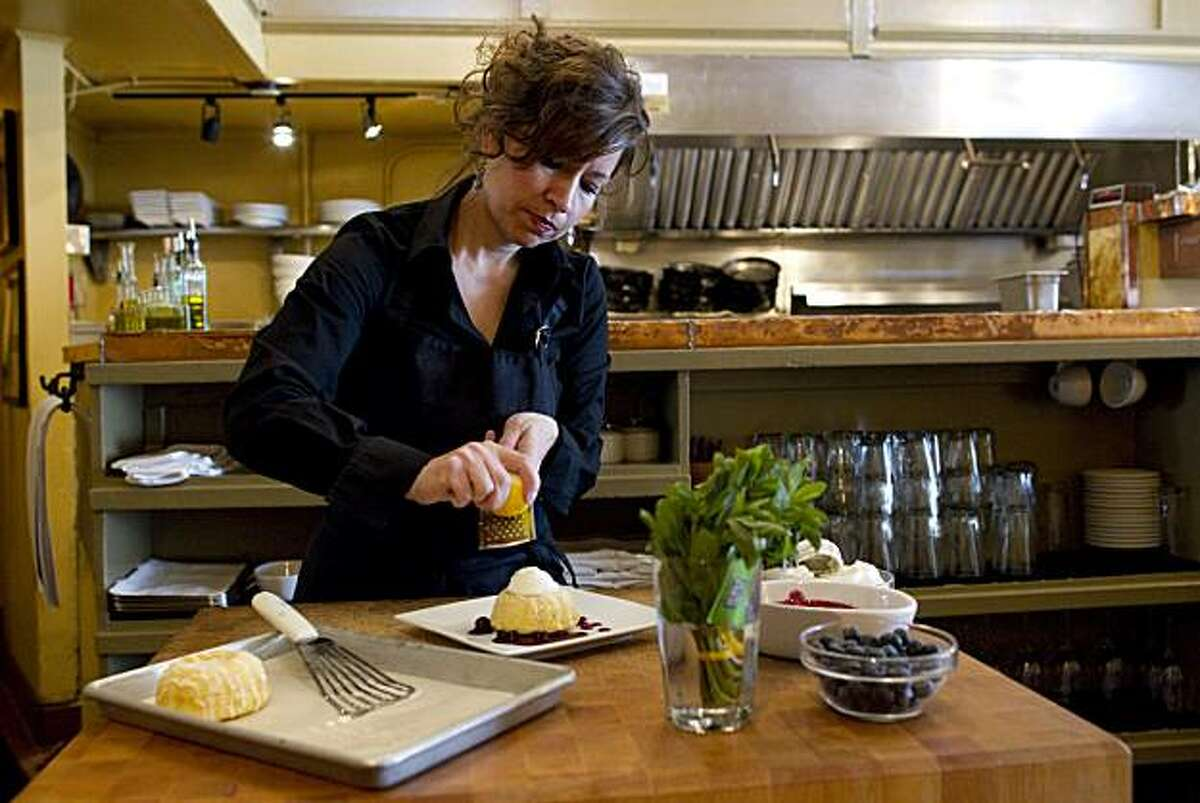 Pastry chef Rebecca Rader plates her Meyer Lemon Tea Cake with Blueberry Compote at Frascati in San Francisco, Calif., on April 5, 2010
