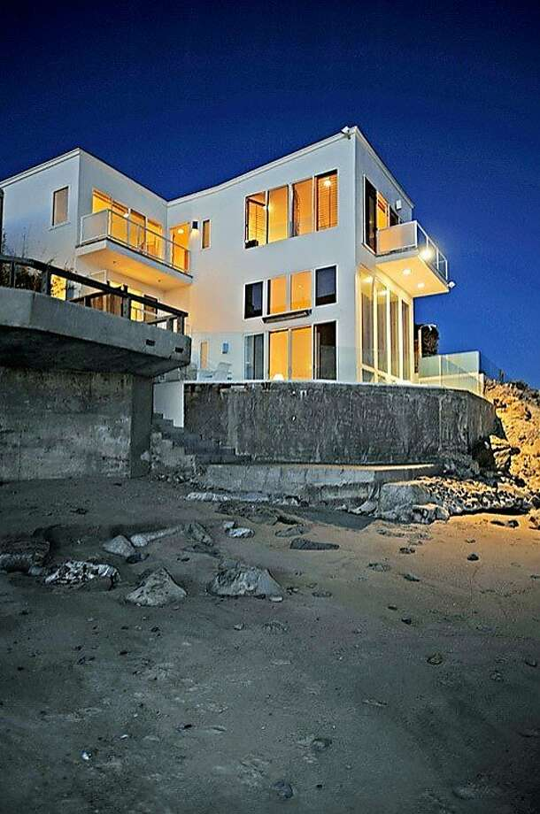 Singer-songwriter Barry Manilow still has his contemporary-style Malibu beach house on the market, after having it originally listed for over $12 million in 2009. The five-bedroom, 4.5-bath home has 3,546 square feet of living space and is on the market for $6.999 million. Photo: Prudential Malibu Realty