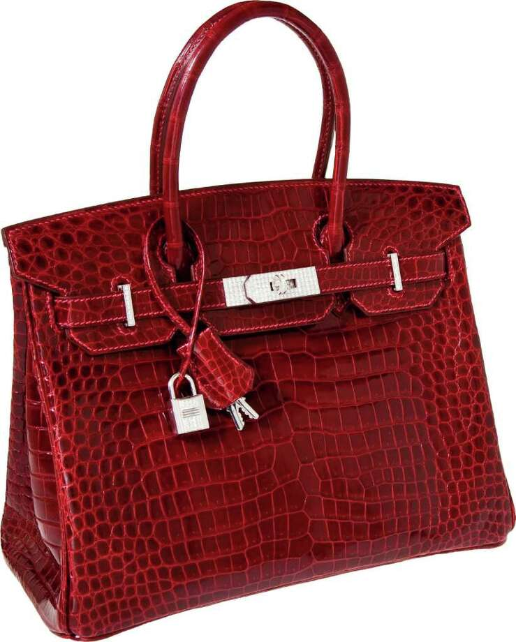 This product image provided by Heritage Auctions shows an Hermès Diamond Birkin handbag that sold for $203,525 in an auction that ended Tuesday, Dec. 6, 2011, in Dallas. Heritage spokesman Noah Fleisher said the bag, made of crocodile hide and featuring 18-karat white gold, diamond-encrusted hardware, went to a collector who wished to remain anonymous. (AP Photo/Heritage Auctions) / Heritage Auctions