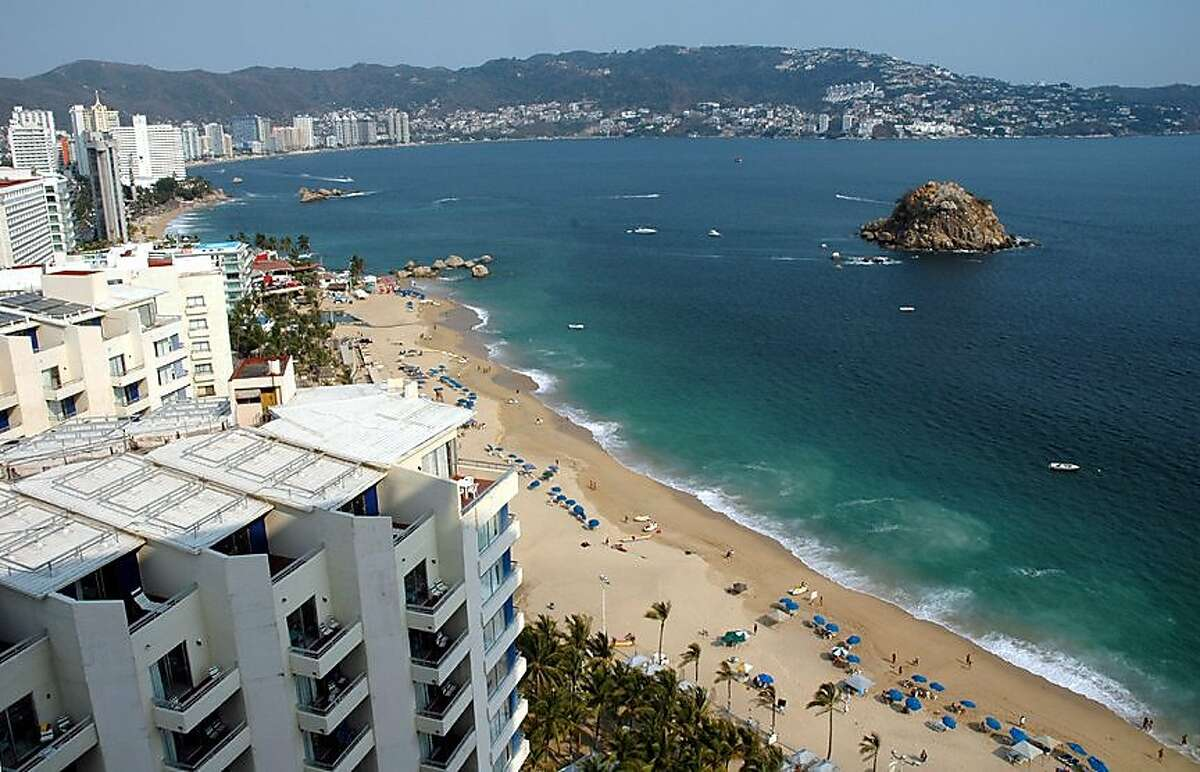 Acapulco Bay seen from a Costera tourist zone hotel. The city's lucrative port is a bone of contention among rival drug cartels.