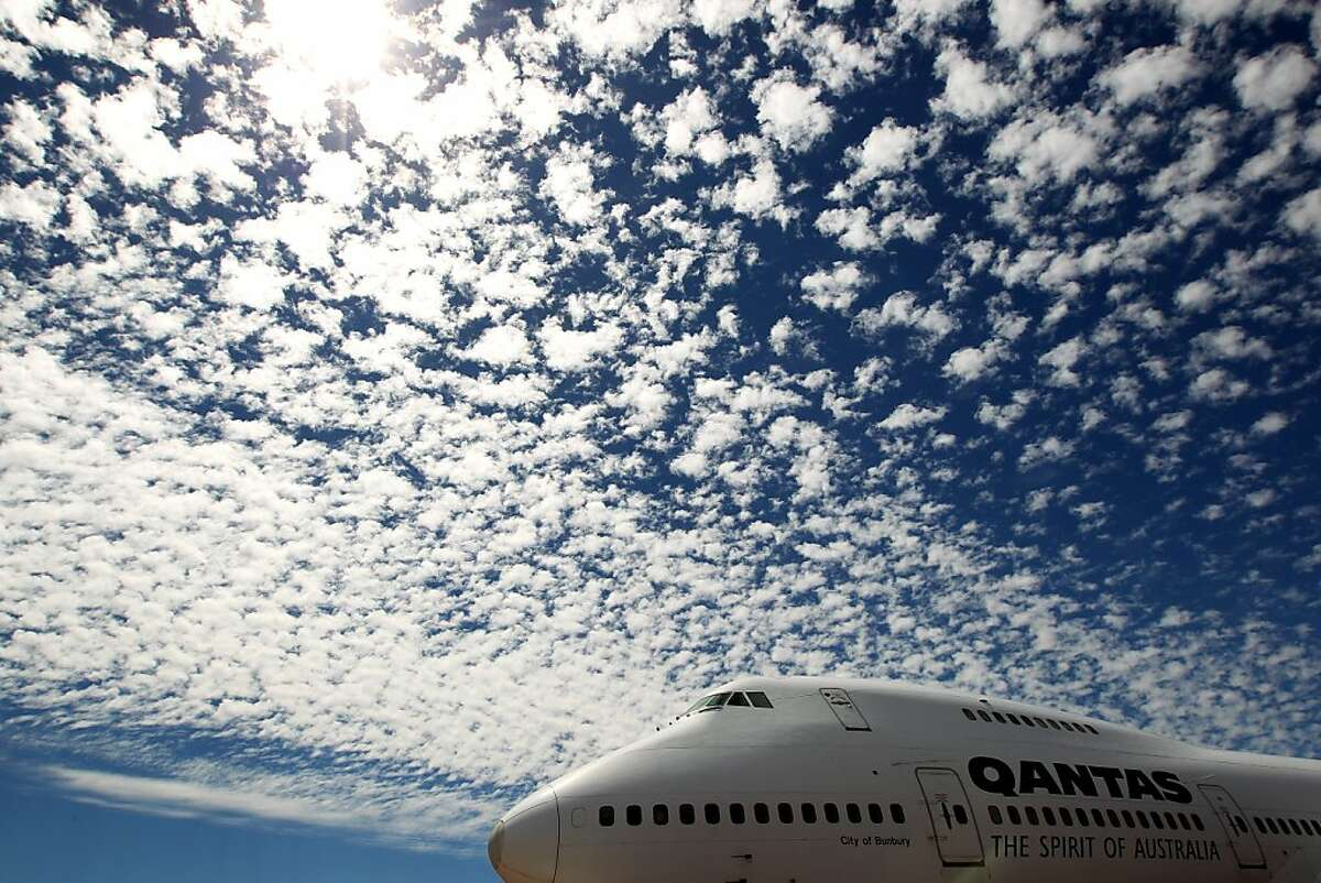 """LONGREACH, AUSTRALIA - MARCH 25: An ex-Qantas 747-200 on permanent display and open for guided tours at the Qantas Founders Museum is seen on March 25, 2011 in Longreach, Australia. Queensland recently suffered a series of extreme floods from December 2010 to January 2011, affecting more than 200,000 people across more than 70 towns. The State is recovering and after the flooding, many areas of outback Queensland are now thriving with the resulting effect on wildlife and flora being described as """"once-in-a-generation"""". With tourism vital to the State's economy, the Queensland and Australian government have committed AUD10 million in emergency tourism funding to promote travel to the state, highlighting Queensland as """"open for business"""". (Photo by Mark Kolbe/Getty Images)"""