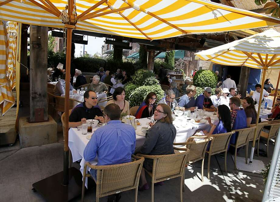 Diners at Angele enjoy eating outdoors on a warm August afternoon. Various popular restaurants in Napa, Calif. including Bistro Don Giovanni, Angele, Morimoto Napa and eating places in the Oxbow Public Market. Photo: Brant Ward, The Chronicle