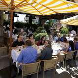 Diners at Angele enjoy eating outdoors on a warm August afternoon. Various popular restaurants in Napa, Calif. including Bistro Don Giovanni, Angele, Morimoto Napa and eating places in the Oxbow Public Market.