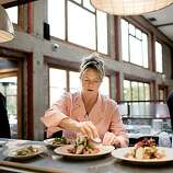 Foreign Cinema chef and owner Gayle Pirie preps plates in the kitchen before they are taken to the tables during dinner.