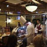 SIX05_PRIMERIB_01_JOHNLEEPICTURES.JPG SAN FRANCISCO, CA - SEPT 13:  Chef Francisco Villa (cq), center, carving pieces of prime rib from one of the restaurant's silver carts in the front dining room at the House of Prime Rib in San Francisco. By JOHN LEE/SPECIAL TO THE CHRONICLE
