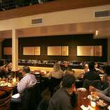 The dining area under the mezzanine at Nopa that has been soundproofed in San Francisco, Calif., on May 28, 2008.