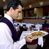 ONE MARKET: A waiter serves a dish at One Market Restaurant in San Francisco.