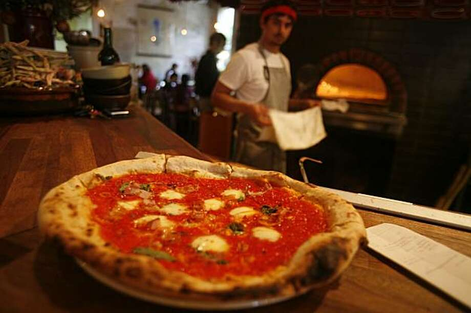 A margheritia pizza waits for its customer at Pizzaiolo on Friday Oct. 3, 2008 in Oakland, Calif. Photo: Mike Kepka, The Chronicle