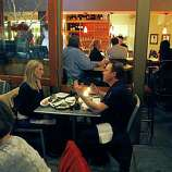A couple dines on the heated patio of Sushi Ran Wine Bar in Sausalito. The upscale restaurant offers a full bar featuring dozens of different Sake and both Japanese and Mediterranean style dishes.  Friday Dec 19, 2008.