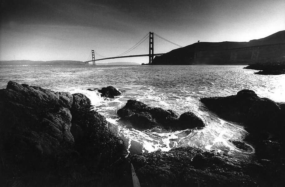 April 14, 1987 - The Golden Gate Bridge as seen from the rocks near the eastern edge of the Presidio Marina on the Marin County side. Photo: Tom Levy, The Chronicle
