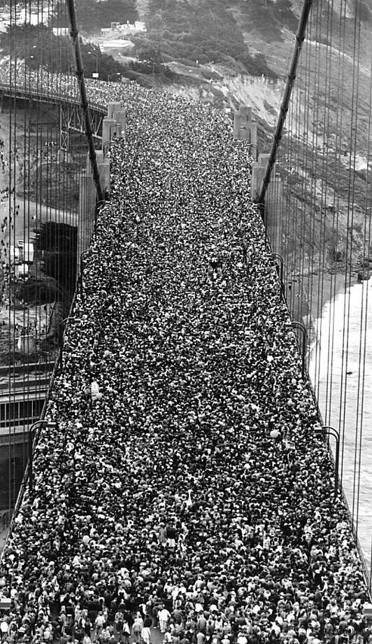 May 24, 1987 - Shot from the South Tower facing south down onto the roadway overlooking a mass of people at the 50th anniversary celebration for the Golden Gate Bridge. Photo: Deanne Fitzmaurice, The Chronicle