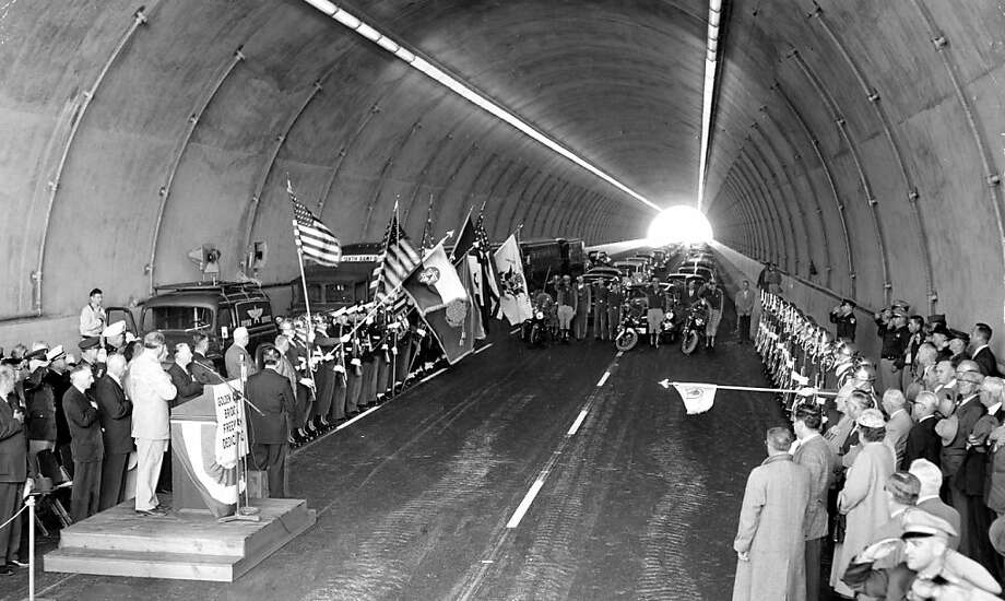 March 21, 1956 - Speeches and band music were the order of the day inside the old Waldo Tunnel yesterday, but outside, cannon boomed, jet fighters swooped and an Army M-47 tank roared around. It was all part of the ceremony opening the new tunnel, which doubles Marin approaches to the Golden Gate Bridge. Photo: Duke Downey, The Chronicle